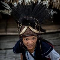 Adi-Monyong tribeman in warrior attire